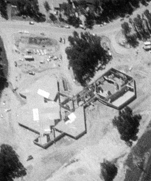 Black and white aerial photograph of Sunrise Valley Elementary School taken in 1979. The building is only partially completed. Classroom sections are under roof, but the cafeteria and main office are still in progress.