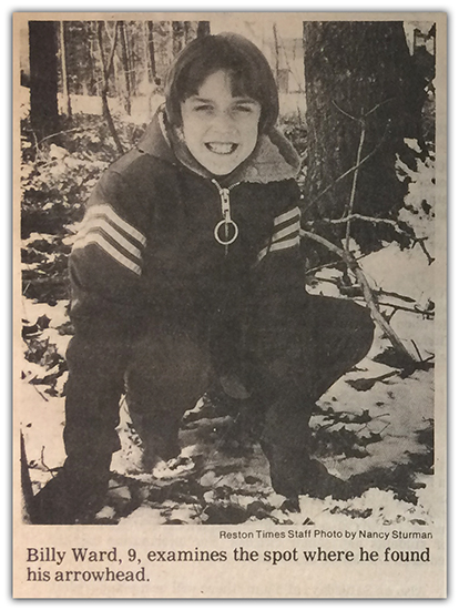 Photograph of a Reston Times newspaper article picture showing Billy Ward. The caption reads Billy Ward, 9, examines the spot where he found his arrowhead.