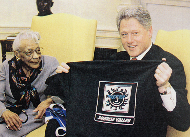 Photograph of Ella Miller with President Clinton in the Oval Office from Sunrise Valley Elementary School's 1995 to 1996 yearbook.