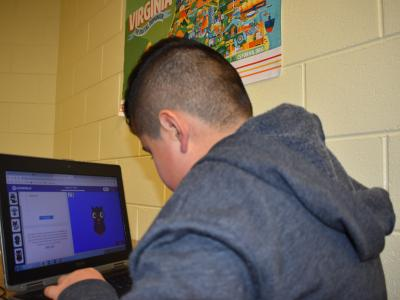 a photo of a student at laptop