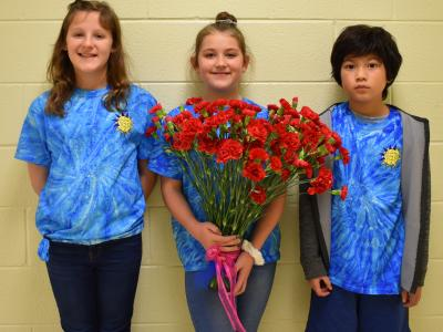 a photo of students with flowers