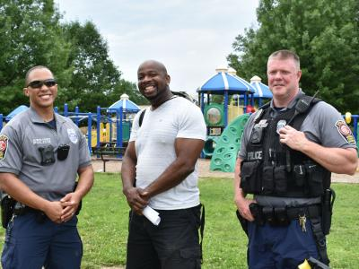 a photo of police officers and P.E. teacher